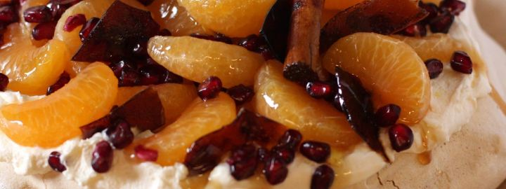 Caramelised clementine and pomegranate pavlova
