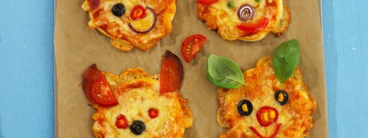 Pizzas with funny faces