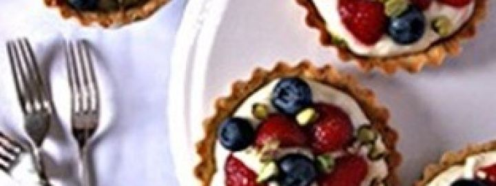 Strawberry, blueberry and pistachio tartlets